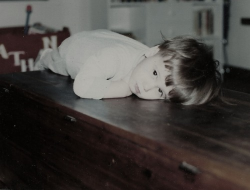 I shall never part with this photo of my first son lying atop my grandmother's cedar chest?